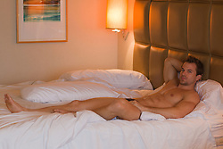 hot man in a bedroom