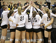 West Point, NY - Army players and coaches gather in a ciricle on the court after defeating Lehigh in a Patriot League women's volleyball tournament match at the United States Military Academy on Nov. 21, 2009.