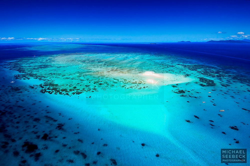 An aerial photograph of Upolu Cay on the Great Barrier Reef, taken on a fine day.<br /> <br /> Limited Edition print