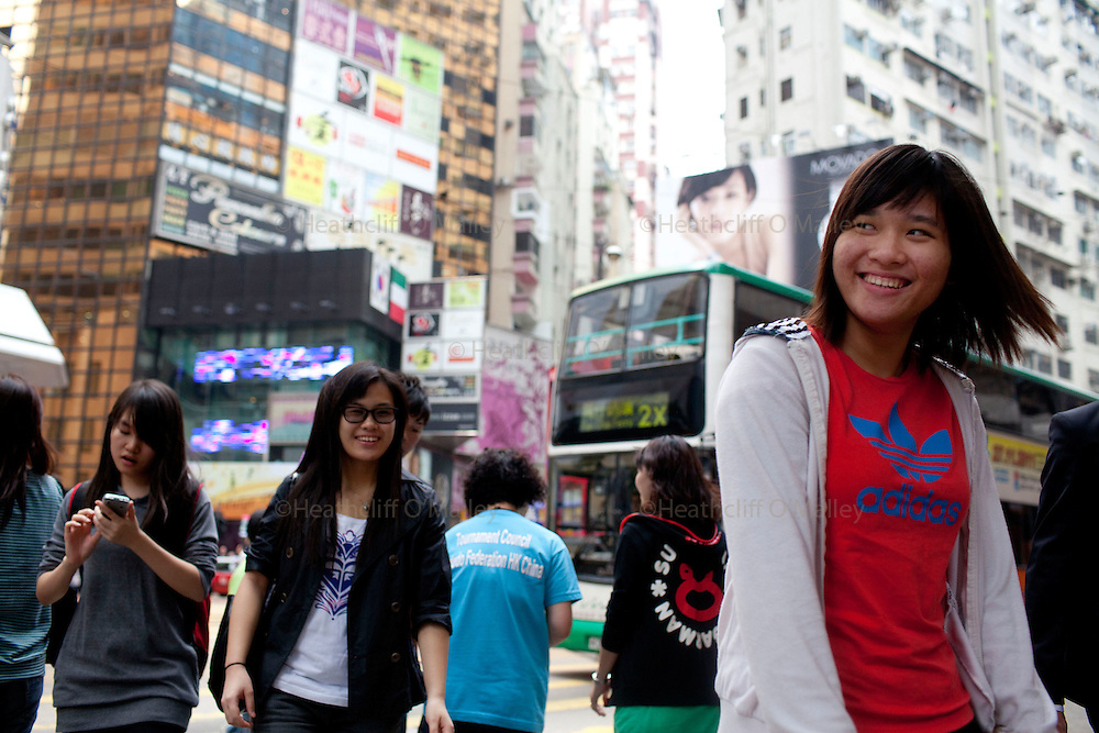 Mcc0034623 .  Daily Telegraph..People on the Yee Wo Street crossing close to the Sogo department store, in the Causeway Bay area of central Hong Kong...Hong Kong 6 October 2011