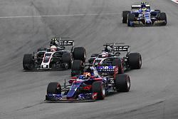 October 1, 2017 - Sepang, Malaysia - Motorsports: FIA Formula One World Championship 2017, Grand Prix of Malaysia, ..#10 Pierre Gasly (FRA, Scuderia Toro Rosso), #8 Romain Grosjean (FRA, Haas F1 Team), #20 Kevin Magnussen (DNK, Haas F1 Team) (Credit Image: © Hoch Zwei via ZUMA Wire)