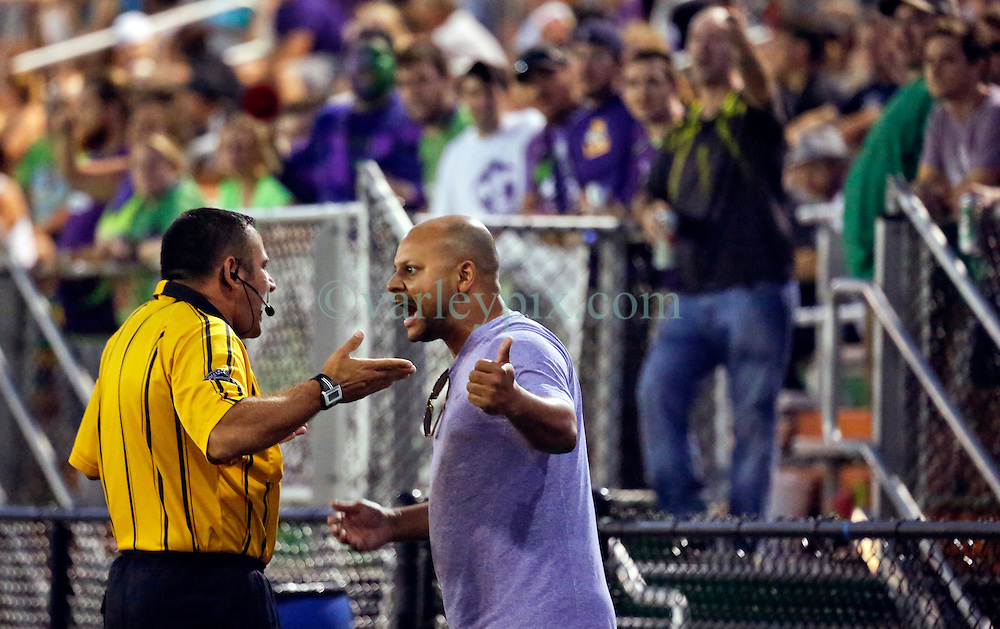 22 June 2016. New Orleans, Louisiana.<br /> NPSL Soccer, Pan American Stadium.<br /> New Orleans Jesters v Nashville FC. Jesters in debate with officials on the sidelines. Jesters emerge victorious with a 2-0 win.<br /> Photo; Charlie Varley/varleypix.com