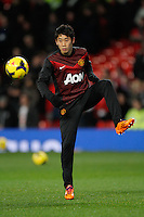 Manchester United's sub Shinji Kagawa warms up before the Barclays Premier League - Manchester United v Cardiff City- Old Trafford, Manchester, England<br /> challenge during the Barclays Premier League - Manchester United v Cardiff City- Old Trafford, Manchester, England