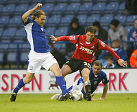 Photo: Steve Bond/Richard Lane Photography. Leicester City v Swansea City. FA Cup Third Round. 02/01/2010. Joe Allen (C) has the ball taken away from him by Robbie Neilson (L)