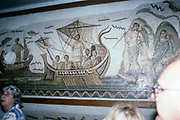 Bardo national museum, Tunis, Tunisia in 1998 - Tour group of people looking at Roman mosaics, Ulysses in ship and Sirens