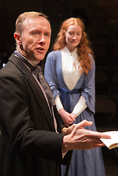 """© Licensed to London News Pictures. 21/11/2013. London, England. Pictured: Daniel Crossely as John Ruskin and Emma West as Lizzie Siddal. World premiere of the play """"Lizzie Siddal"""" at the ARcola Theatre, Hackney, London. The play tells the story of the woman who was 'Ophelia' in Millais' famous painting. Running from 20 November to 21 December 2013. With Emma West as Lizzie Siddal and Tom Bateman as Dante Gabriel Rossetti. Photo credit: Bettina Strenske/LNP"""
