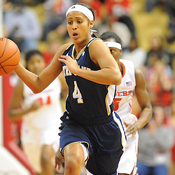 Notre Dame Fighting Irish guard Skylar Diggins (4) dribbles up court during first half NCAA Big East women's basketball action between Notre Dame and Rutgers at the Louis Brown Athletic Center. Notre Dame leads 40-23 at halftime.