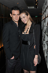 PETRA NEMCOVA and JAMIE BELMAN at a party to celebrate the 15th birthday of Vogue.com held at W Hotel, Leicester Square, London W1 on 17th February 2011.