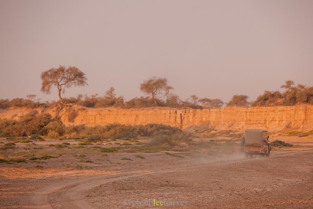 Land rover driving down dirt track, The Kaokoveld Desert, Kaokoland, Northern Namibia, Southern Africa