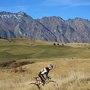 Dayle McLaughlin tackles the course with The Remarkables mountain range providing the backdrop during the New Zealand Cyclocross Championships sponsored by AJ Hackett Bungy, held at Jardine Park,  Queenstown, as part of the Queenstown WInter Festival. The men's event was won by Dan Warren from Hastings while Anja McDonald from Dunedin won the women's event. Queenstown, New Zealand, 3rd July 2011