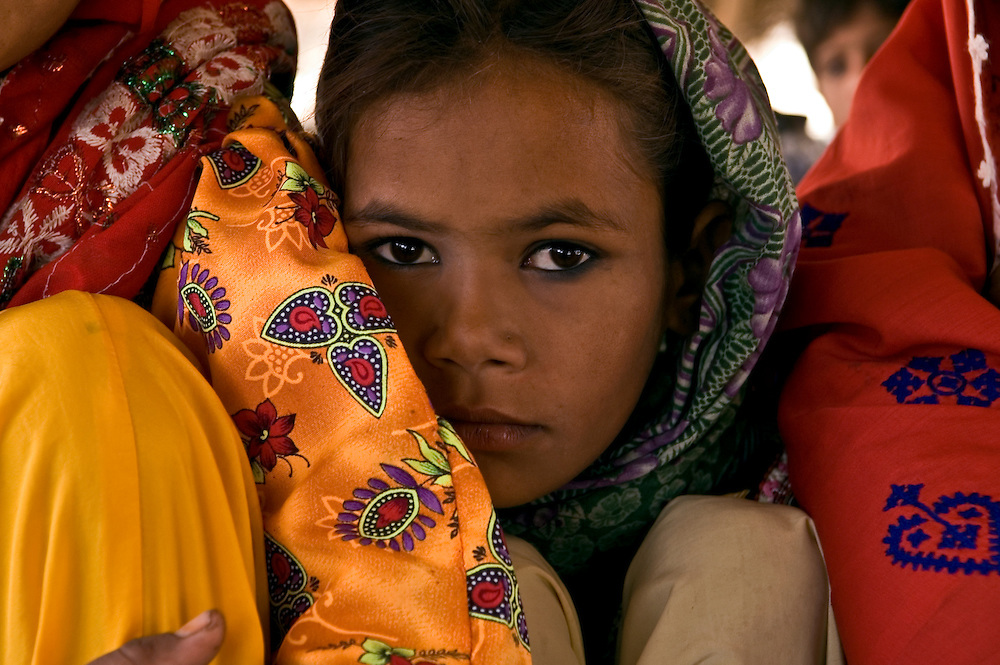 Rani, a young Pakistani girl, tucked in among the women of her village.