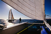 Team Adventure, helmed by Team Adventure off the Coast of Antibewiht Club Med before the start of The Race, a round the world, no limits race.  These are the world's fastest sailboats attaining speeds of more than 40 knots.