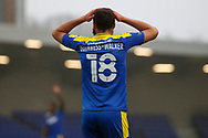 AFC Wimbledon defender Nesta Guinness-Walker (18) with hands on his head during the EFL Sky Bet League 1 match between AFC Wimbledon and Milton Keynes Dons at Plough Lane, London, United Kingdom on 30 January 2021.