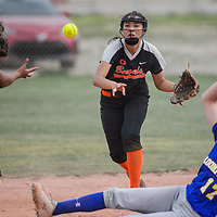 Gallup Bengal Mikayla Yazzie (4) tosses the ball to teammate LeiLani Yermen (5) as Bloomfield Bobcat Ashley Lewellen (17) slides into second base Thursday at Gallup High School.