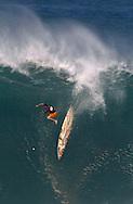 "Santa Cruz's Darryl ""Flea"" Vitrostko wipes out, breaking his leg, during the Quiksilver In Memory of Eddie Aikau Big Wave invitational at Waimea Bay, Hawaii Tuesday December 15, 2004."