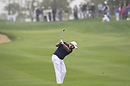 Shane Lowry (IRL) plays his 2nd shot on the 1st hole during Saturay's Round 3 of the 2014 BMW Masters held at Lake Malaren, Shanghai, China. 1st November 2014.<br /> Picture: Eoin Clarke www.golffile.ie