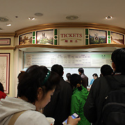The queue for entrance tickets at Lotte World. Lotte World is the world's largest indoor theme park which includes shopping malls, a luxury hotel, and an Ice rink. Opened on July 12, 1989, Lotte World receives over 8 million visitors each year. Seoul, South Korea. 21st March 2012. Photo Tim Clayton