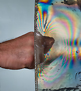 The force generated by a knuckle punch is visualized by using polarized light to show the stress generated in ballistic gel.