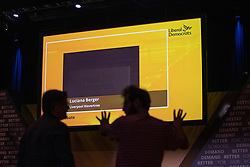 © Licensed to London News Pictures . 13/09/2019. Bournemouth, UK. Technicians discuss the layout of the conference hall as a slide featuring the name of former Labour Party MP Luciana Berger , who defected to the Liberal Democrats , is shown on the main screen . Preparations are made ahead of the Liberal Democrat Party Conference in Bournemouth . Photo credit: Joel Goodman/LNP