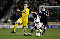 Photo: Pete Lorence.<br />Derby County v Bristol Rovers. The FA Cup. 27/01/2007.<br />Steve Elliot evades a tackle by Paul Peschisolido.