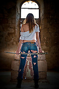 Aggressive Young woman in her 20's with a Samurai Sword