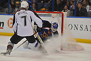 St. Louis Blues goalie Brian Elliott (1) grabs for the puck after a shot by Colorado Avalanche center John Mitchell (7) and a shower of ice particles in the second period of a game between the Colorado Avalanche and the St. Louis Blues on Tuesday April 23, 2013 at the Scottrade Center in downtown St. Louis.