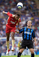 Photo: Daniel Hambury.<br /> Portsmouth v Inter Milan. Pre Season Friendly.<br /> 31/07/2005.<br /> Portsmouth's John Viafara beats Inter's Esteban Cambiasso to the ball.
