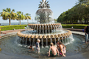 People cool off in the Pineapple fountain at Waterfront Park as the southeast experiences a record setting heat wave June 22, 2015 in Charleston, South Carolina. Charleston has tied the historic record of 98-degrees (37 Celsius) and more hot weather is expected into next week.