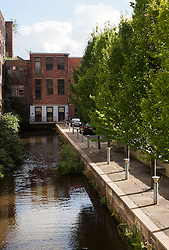 Manchester Bridgewater Canal close to Saint Georges Island. Smartly refurbished buildings turned into city living space cheek by jowl with untouched derelict buildings..29  September 2012.Image © Paul David Drabble