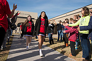 Iraan High School cheerleader Lauren Garlock leads the cheerleaders and football team to the busses taking them to Arlington for the football state title game in Iraan, Texas on December 14, 2016. (Cooper Neill for The New York Times)