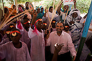 British Labour peer, Lord Ahmed of Rotherham dances with local women and children in a compound of the govenor of north Darfur, Osman Mohammed Yousef Kibir at Al Fashir, Sudan. Nazir, Baron Ahmed (born 1958) is a member of the House of Lords, having become the United Kingdom's first Muslim life peer in 1998 and is in this war-torn province of Sudan to attend the first-ever international Conference on Womens' Challenge in Darfur, hosted by the govenor in his own compound.