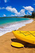 Kayak and paddle on beach on Hanalei Bay, Island of Kauai, Hawaii USA