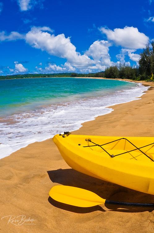 Kayak and paddle on beach on Hanalei Bay, Island of Kauai, Hawaii USA