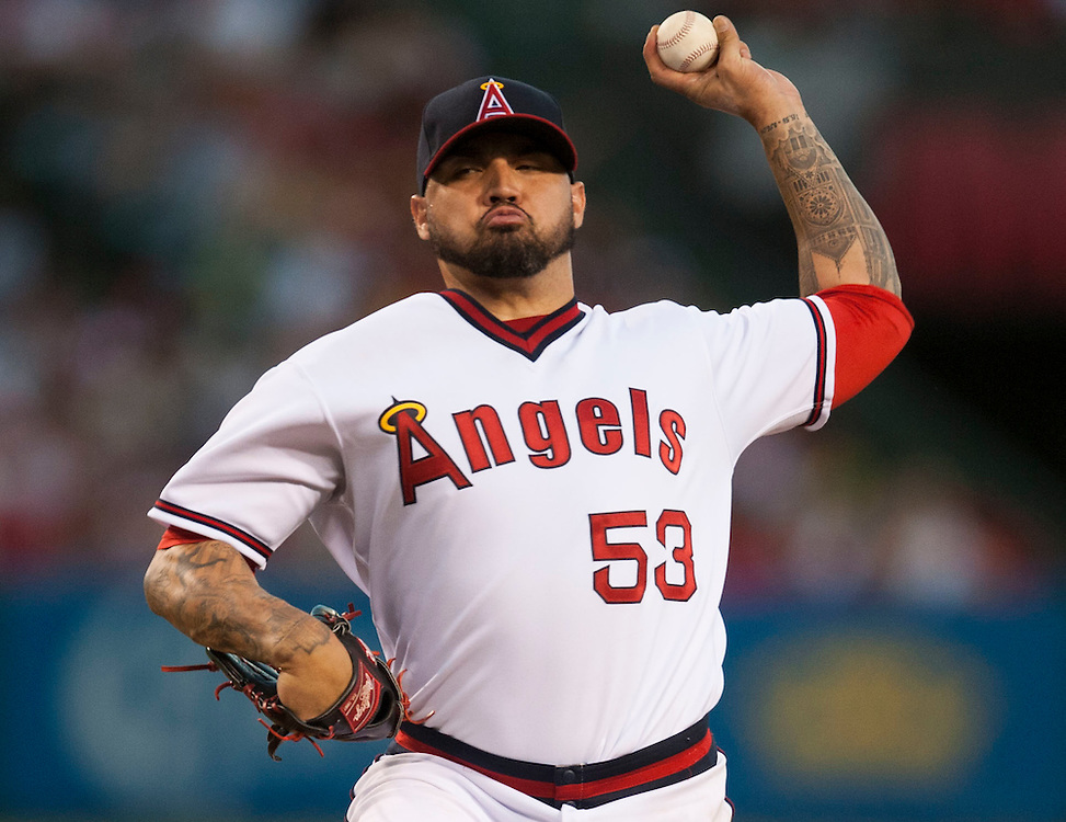 The Angels' Hector Santiago pitches against the Texas Rangers at Angel Stadium on Wednesday.<br /> <br /> ///ADDITIONAL INFO:   <br /> <br /> angels.0721.kjs  ---  Photo by KEVIN SULLIVAN / Orange County Register  -- 7/20/16<br /> <br /> The Los Angeles Angels take on the Texas Rangers at Angel Stadium.