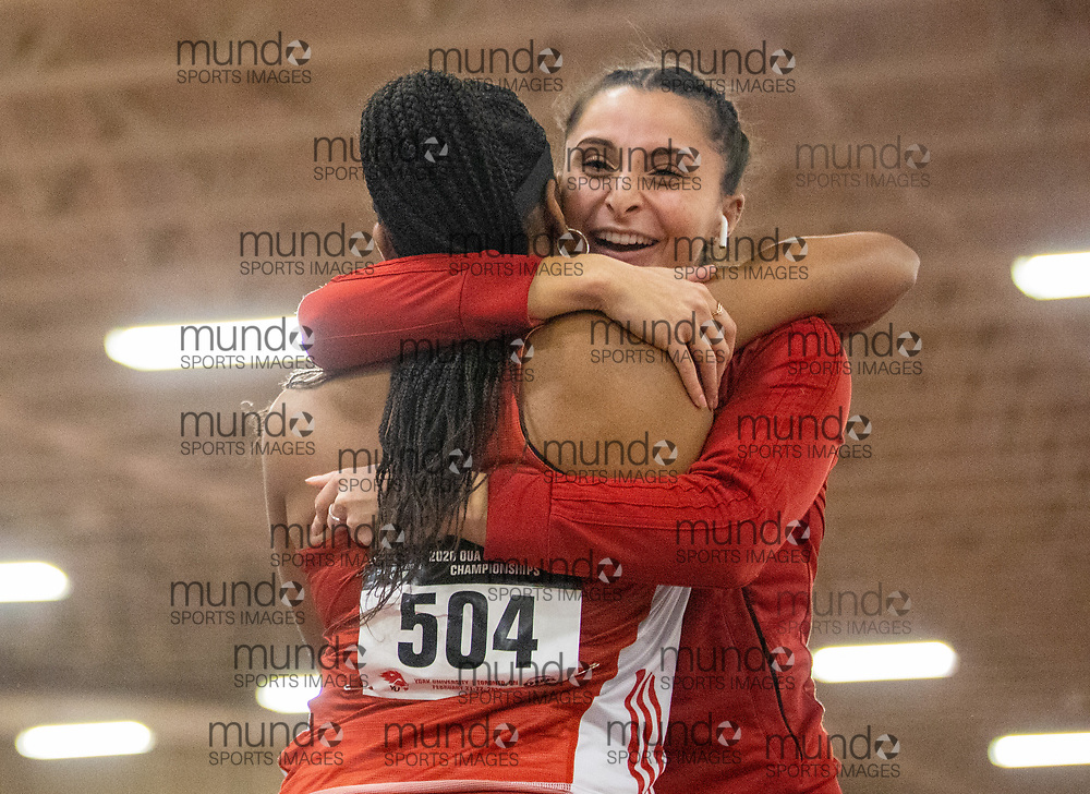 (February 22, 2020 -- Ottawa, Ontario) Simon Da Silva of York hugs teammate Diana Boa after the Lions win bronze in the 4x200m relay  at the 2020 OUA Track and Field Championships at the Toronto Track and Field Centre on the campus of York University.<br /> Copyright Miles Ryan Rowat / Mundo Sport Images