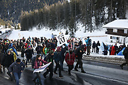 The third and last day of the Strike WEF march to Davos on 21st of January 2020 in Davos, Switzerland. The march is coming off the path to cross the main road to Davos. Some of the activists wanted to take the road for political reasons but police blocked them from doing so. No arrests were made. The authorities had refused permission for the march to walk on the road into Davos so many hiked across the mountains from Klosters to get there. The march is a three day protest against the World Economic Forum meeting in Davos. The activists want climate justice and think that The WEF is for the worlds richest and political elite only.