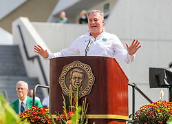 """Oct 9, 2021; Huntington, West Virginia, USA; Marshall Thundering Herd men's basketball head coach Dan D'Antoni speaks during a ceremony honoring the life of Harold Everett """"Hal"""" Greer and to reveal a statue of him outside the Cam Henderson Center. Mandatory Credit: Ben Queen-USA TODAY Sports"""