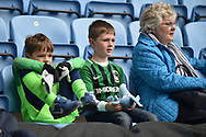 A Family of Coventry City fans wait for kick off during the EFL Sky Bet League 1 match between Coventry City and Shrewsbury Town at the Ricoh Arena, Coventry, England on 28 April 2019.