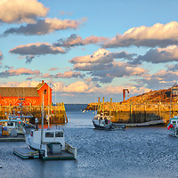 New England photography of the famous red fishing shack Motif Number One in Rockport, MA on Cape Ann at sunset. The historic landmark is known throughout New England as Motif #1, so called because it is the most often painted building in America.<br />