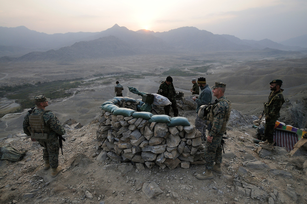 """US Marine Sgt Major Patrick Dougherty (left) and Marine Colonel Jeff Haynes, Commanding Officer, 201st Regional Corps Advisory Command, (right) overlooking the Tagab Valley from an ANA observation post...   ..Haynes said the battle plan, """"The creeping barrage of goodness,"""" to win the hearts and minds of the Tagab Valley includes: a paved road, wells, radio stations, solar power, humanitarian aid, and medical outreach.  Agricultural development teaching how to package goods, and pruning techniques to increase crop yields.  Saffron cultivation started too, as a replacement to poppy.  More projects like schools and police checkpoints will follow as resources allow..."""