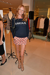 OLIVIA INGE at the launch of the 'Jasmine for Jaeger' fashion collection by Jasmine Guinness for fashion label Jaeger held at Fenwick's, Bond Street, London on 9th September 2015.