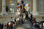 French fans wait the team France at the concorde Plaza during the parade of the team France on Champ-Elysées after winning the 2018 FIFA World Cup Russia on July 16, 2018 in Paris, France - Photo Philippe Millereau / KMSP / ProSportsImages / DPPI