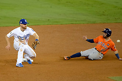 November 1, 2017 - Los Angeles, CA, United States - Astros Jose Altuve, #27, beat the throw to Dodgers Logan Forsythe, #11, for a steal during 6th inning action at 7 at the World Series at Dodger Stadium Wednesday, November 1, 2017. (Credit Image: © David Crane/Los Angeles Daily News via ZUMA Wire)