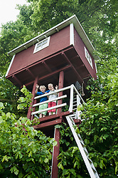 Tree-house two boys friends playing waving