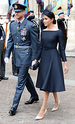 Meghan, Duchess of Sussex (right) and Prince Harry during the RAF Centenary at Buckingham Palace, London. Photo credit should read: Doug Peters/EMPICS