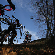 Competitors in action as they climb a hill in the Men's Category 4/5 race during the The 3rd Annual Newtown Cyclocross Race in the Fairfield Hills and the Town's Municipal Center. Newtown, Connecticut, USA. 15th November 2015. Photo Tim Clayton