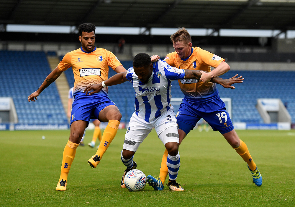 Colchester United's Ryan Jackson battles with Mansfield Town's Jacob Mellis and Johnny Hunt<br /> <br /> Photographer Hannah Fountain/CameraSport<br /> <br /> The EFL Sky Bet League Two - Colchester United v Mansfield Town - Saturday 7th October 2017 - Colchester Community Stadium - Colchester<br /> <br /> World Copyright © 2017 CameraSport. All rights reserved. 43 Linden Ave. Countesthorpe. Leicester. England. LE8 5PG - Tel: +44 (0) 116 277 4147 - admin@camerasport.com - www.camerasport.com