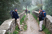 Liana and Parmenter Welty pause on a stone bridge outside of Sarria along the Camino de Santiago pilgrimage, Galicia, Spain.