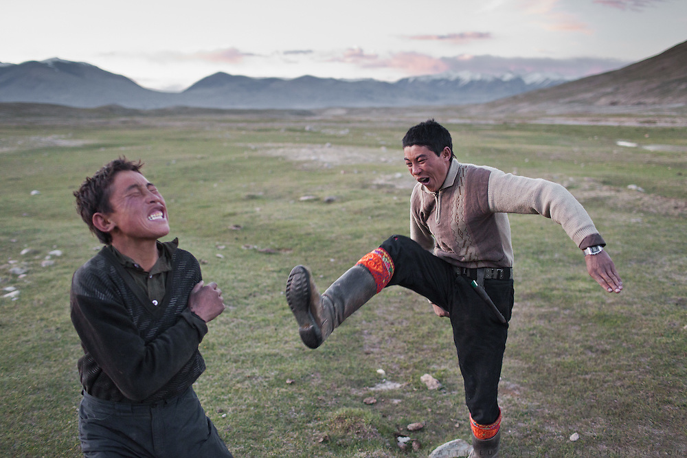 Nemat Ullah and Rosman Baig playing Kung Fu moves inspired from action movies they have watched on their mobile phone..Daily life at the Khan (chief) summer camp of Kara Jylga...Trekking through the high altitude plateau of the Little Pamir mountains (average 4200 meters) , where the Afghan Kyrgyz community live all year, on the borders of China, Tajikistan and Pakistan.