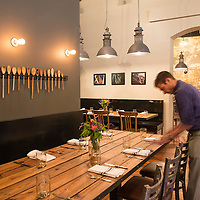 A waiter sets a table at Rhubarb. Chef John Fleer's restaurant Rhubarb is located at 7 SW Pack Square in Downtown Asheville, North Carolina.